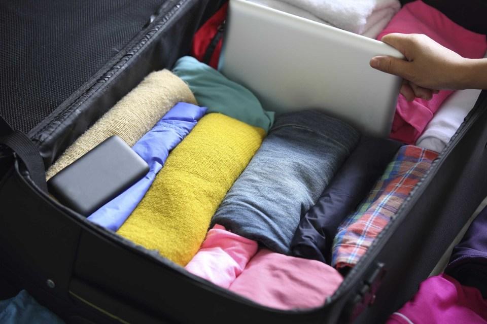 """スーツケースの中身を美しく見せる「荷物の詰め方」:""""たった5つの工夫""""で劇的に変わる旅行前の準備 3番目の画像"""